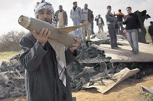 Libyans pose with the wreckage of a US F15 fighter jet after it crashed near the village of Bu Mariem, east of Benghazi, Libya, yesterday. Both crew ejected safely