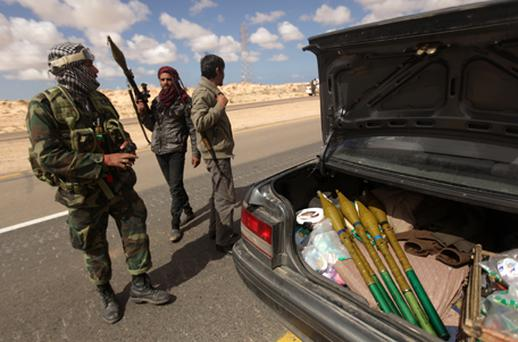 Libyan rebels unload rocket propelled grenades from a car as they massed for a second day outside the key city of Ajdabiya. Photo: Getty Images