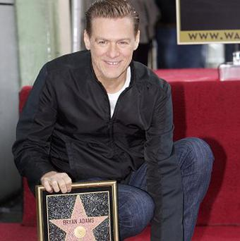 Canadian singer Bryan Adams is honoured with a star on the Hollywood Walk of Fame