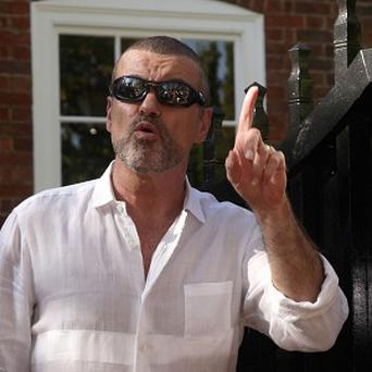 George Michael has hit back at bad reviews of his album