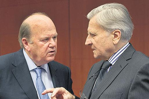 ECB boss Jean-Claude Trichet with Finance Minister Michael Noonan: Mr Trichet this week told Ireland that it could – and would – repay all its debts