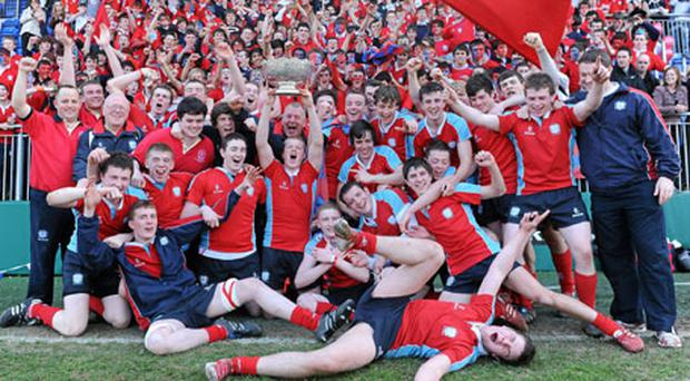 The CUS squad celebrate in front of their supporters after their victory over Newbridge College in the Vinnie Murray Cup final at Donnybrook yesterday. Photo: Matt Browne / Sportsfile
