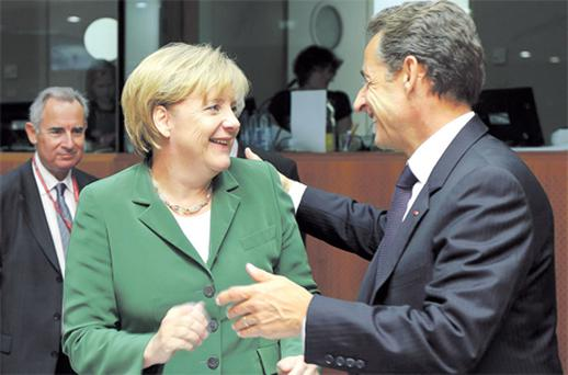 Franco German axis: German Chancellor Angela Merkel and French President Nicolas Sarkozy are demanding quid pro quo from Ireland in conceding a new, less onerous deal to help Ireland escape the tightening debt spiral