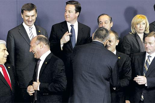 At the EU summit in Brussels were, front row, left to right: Cypriot President Dimitris Christofias; Romania's President Traian Basescu; Bulgarian Prime Minister Boyko Borissov; Poland's Prime Minister Donald Tusk, and Taoiseach Enda Kenny. Back row left to right: Estonia's Prime Minister Andrus Ansip; British Prime Minister David Cameron; Malta's Prime Minister Lawrence Gonzi; and Slovakia's Prime Minister Iveta Radicova