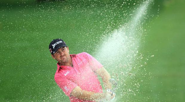 Graeme McDowell plays his third shot at the 15th hole during the first round of the Arnold Palmer Invitational at Bay Hill yesterday. Photo: Getty Images