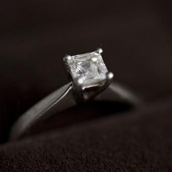 Three men posing as customers stole a £217,000 diamond ring from a Paris department store