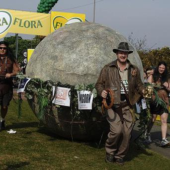 Marathon charity champion Lloyd Scott - seen here dressed as Indiana Jones - is set to take part in an event dressed as a snail