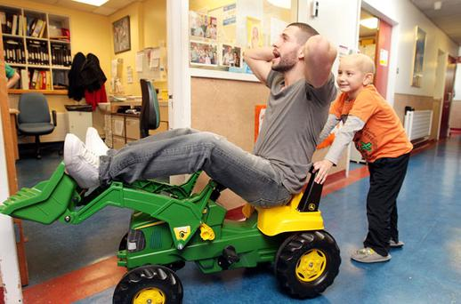 Shayne Ward gets a push from Gerard Gaffney at Our Lady's Children's Hospital. Photo: Mark Condren