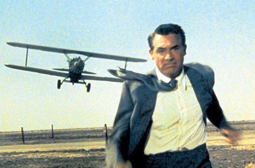Iconic: Cary Grant is chased through a field by a crop-spraying plane in a scene from Hitchcock's stylishNorth by Northwest