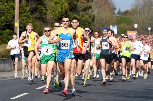 Eventual winner Mark Kenneally of Clonliffe Harriers AC leads the field out at the start of the Irishrail.ie Dunboyne 4 Mile Road Race yesterday. Photo: TOMAS GREALLY / SPORTSFILE