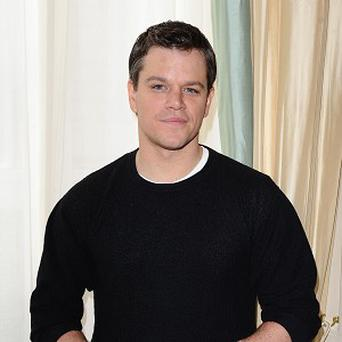 Matt Damon revealed he'll be kissing Michael Douglas more than once