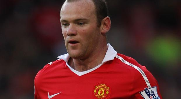 Back on the bench: Wayne Rooney. Photo: Getty Images