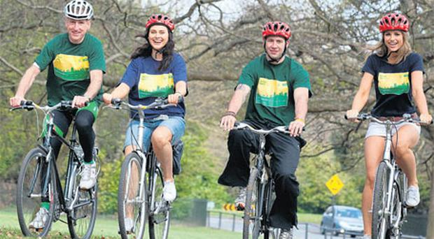 Former Waterford hurler Dan Shanahan (second right) on his bike in the Phoenix Park yesterday with Sean Kelly, Corina Grant and Vogue Williams at the official launch of the An Post Cycle Series, which will take place across the country between May and September to encourage people to get back cycling.