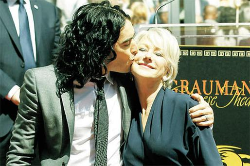 Russell Brand kisses actress Helen Mirren during a ceremony at Grauman's Chinese Theatre in Los Angeles yesterday