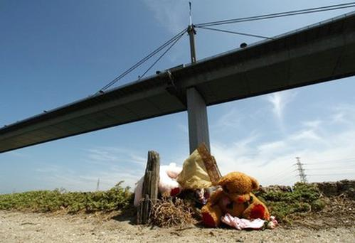 Tributes lay near the bridge where four-year-old Darcey Freeman died