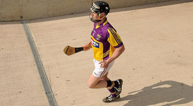 Wexford captain Darren Stamp makes his way out for the start of the game against Offaly last Sunday. Photo: Paul Mohan / Sportsfile