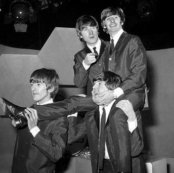 A website that posted digital copies of Beatles music has agreed to pay nearly a million US dollars to settle a lawsuit