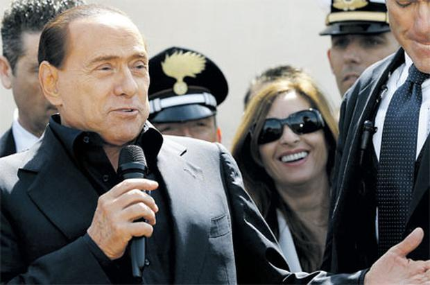 Italian PM Silvio Berlusconi speaks from the Italian island of Lampedusa. Italy prepared to move thousands of illegal Tunisian migrants off the island yesterday after an outcry over a failure to solve a growing immigration problem