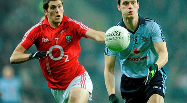 Dublin's Diarmuid Connolly gives Cork's Conor O'Driscoll the slip during their NFL Division 1 Round 2 game in February. If both sides win this weekend, they will meet each other in the Division 1 final no matter what happens in the final round of league matches.
