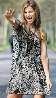 Vogue Williams in an animal print dress (€78) from Warehouse. Photo: James Horan/Collins
