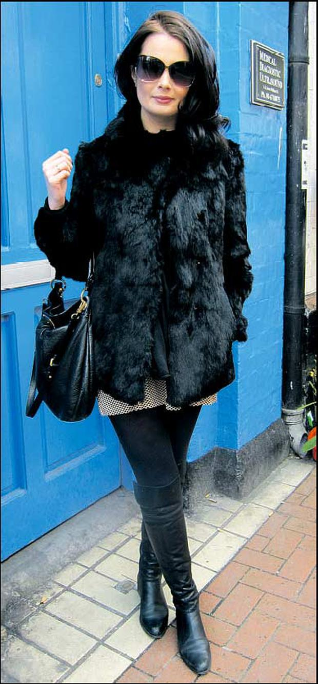 Martha Lynn. Martha makes monochrome work with her effortless over-the-knee flats and glossy fur jacket.