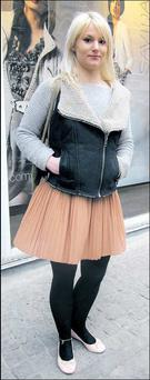 Michelle Campion. Michelle's cosy, aviator style gilet contrasts beautifully with her ethereal, chiffon pleat skirt.