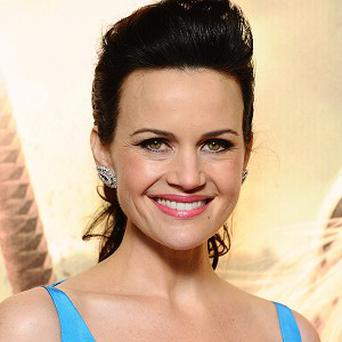 Carla Gugino has been sworn to secrecy about her role in New Year's Eve