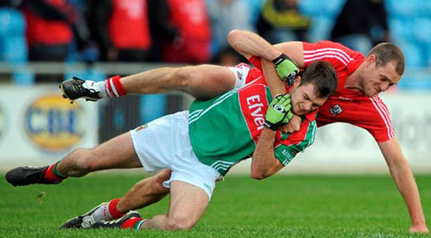 Mayo's Ger Cafferkey and Cork's Pearse O'Neill tussle off the ball during their Allianz Football League clash in Castlebar. Photo: Stephen McCarthy / Sportsfile