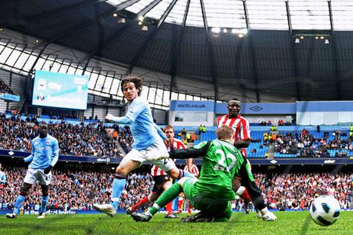 David Silva scores Manchester City's third goal against Sunderland yesterday. Photo: Laurence Griffiths / Getty Images