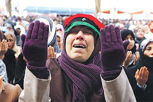 A woman cries during prayers in the rebel stronghold of Benghazi, Libya