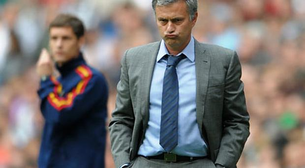 Jose Mourinho in pensive mood during Saturday's match at the Bernabeu. Photo: Getty Images