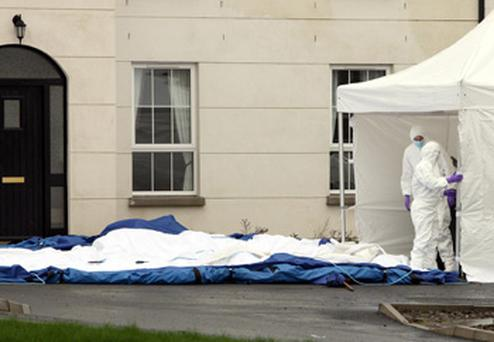 Forensic officers gather evidence outside the home of PC Ronan Kerr, in Omagh, Co Tyrone. Photo: PA