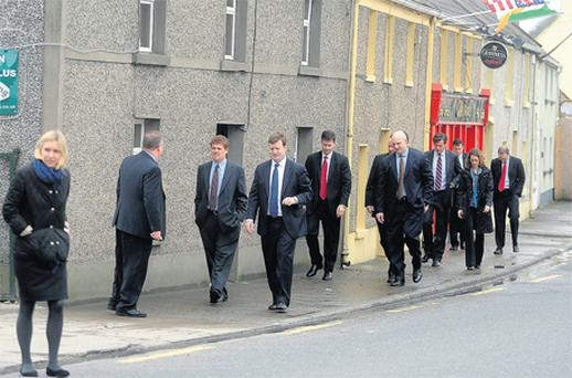 The US security team take a stroll in Moneygall ahead of the visit by Barack Obama