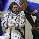 US astronaut Ron Garan speaks to a back up crew member ahead of the mission to the International Space Station (AP)