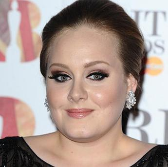 Adele has made pop history as her album 21 completed 10 weeks at number one - the longest for a female solo artist