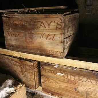 Crates of whisky recovered by a team restoring an Antarctic hut used by famed polar explorer Ernest Shackleton (AP)
