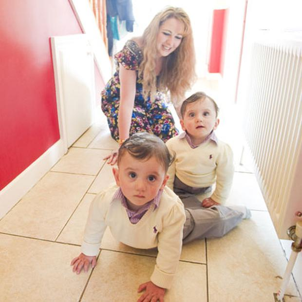 Happy families: Angie with her twins Hassan and Hussein at home in Cork. Photo by Michael MacSweeeney / Provision