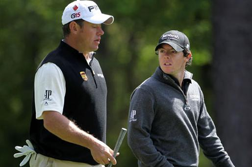 Lee Westwood and Rory McIlroy chat during their practice round prior at Augusta National yesterday. Photo: Getty Images