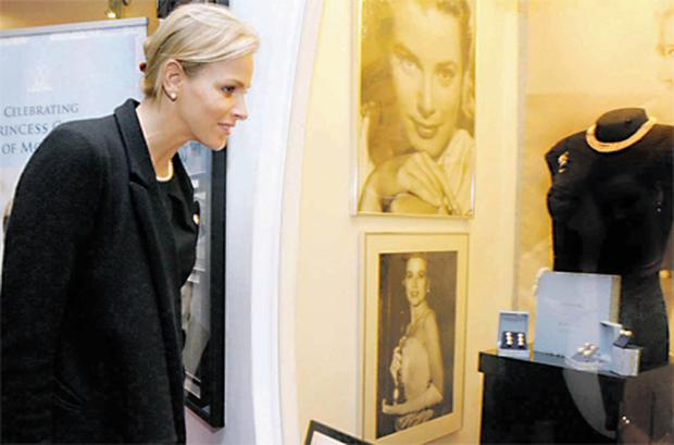 Charlene Wittstock inspects exhibits featuring the late Princess Grace at the 'Museum of Style Icons' in Co Kildare