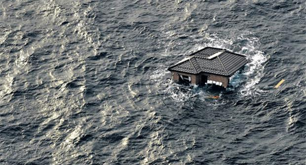 A home adrift in the sea shortly after the March 11 earthquake and tsunami in which more than 10,000 people died