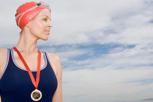 Female swimmer with medal