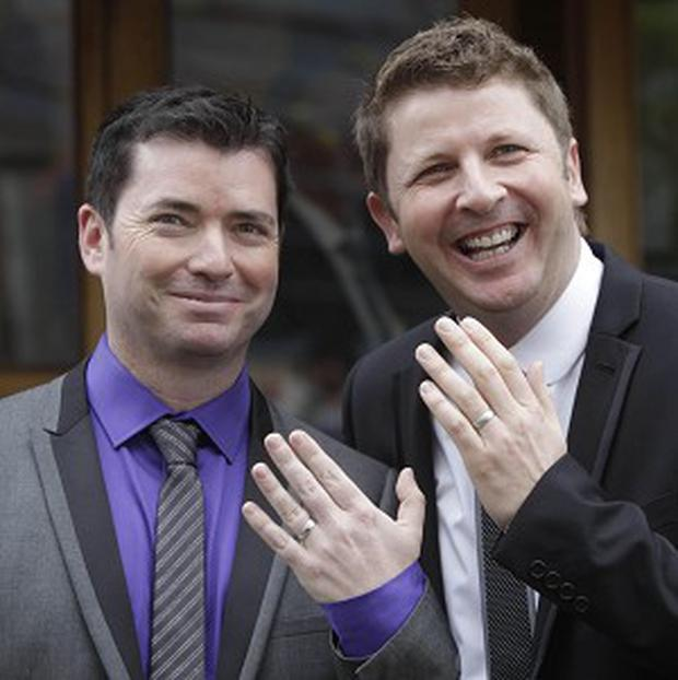 Hugh Walsh and partner Barry Dignam, celebrate having one of the first civil partnerships in Ireland