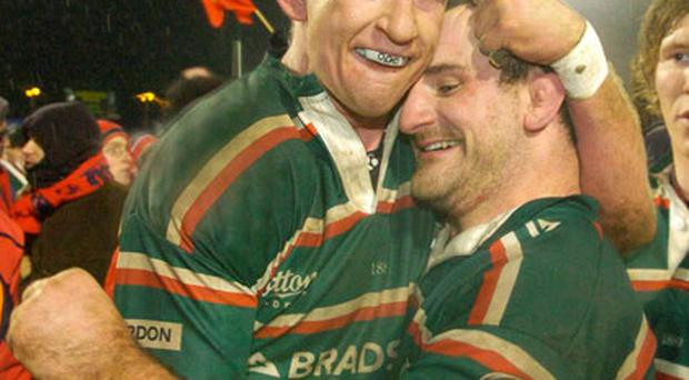 Leo Cullen (L) embraces George Chuter after beating Munster in Limerick in 2007