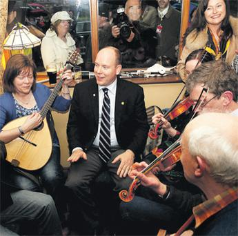 Prince Albert enjoys a trad music session in the Grainne Uaile pub yesterday