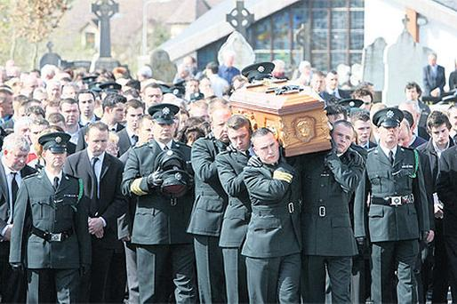 Members of the PSNI carry the remains of Ronan Kerr through Beragh, Co Tyrone, yesterday