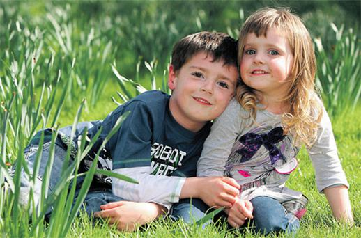 AJ (5) and Rebecca Corbett (3) from Dooradoyle enjoying the sun in the People's Park in Limerick city yesterday