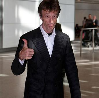Bee Gees star Robin Gibb has cancelled a series of dates in Brazil after being taken to hospital with abdominal pains