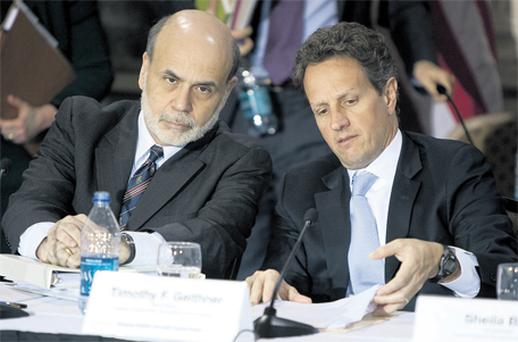 US Fed chairman Ben Bernanke listens to Treasury Secretary Timothy Geithner at a meeting of the Financial Stability Oversight Council meeting in Washington. Quantitative easing and interest rate policy are the two key issues on the agenda