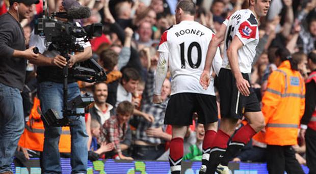 Wayne Rooney celebrating his third goal swore to television cameras. Photo: PA