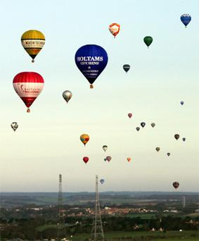 Hot air balloons pictured over Lydden Hill Race Circuit near Canterbury, Kent. Photo: PA